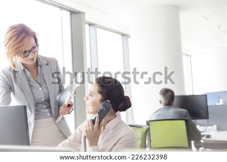 Businesswomen working in office - stock photo
