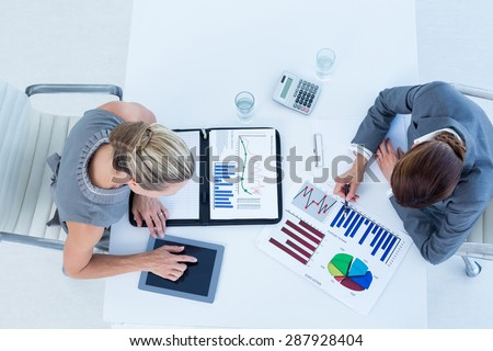 Businesswomen working together in an office - stock photo