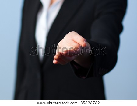Busineswwoman offering a handshake to the camera