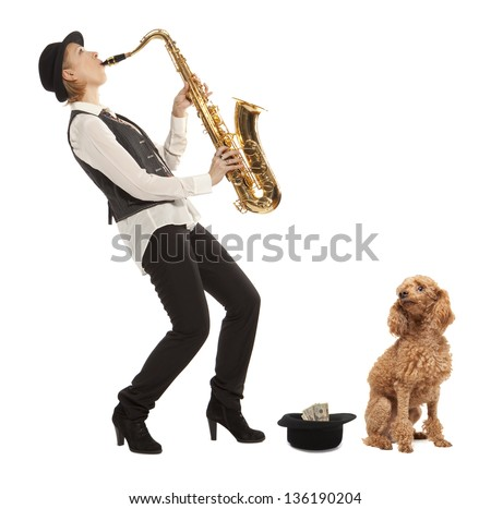 Busker Musician woman with a dog earns money playing the saxophone - stock photo