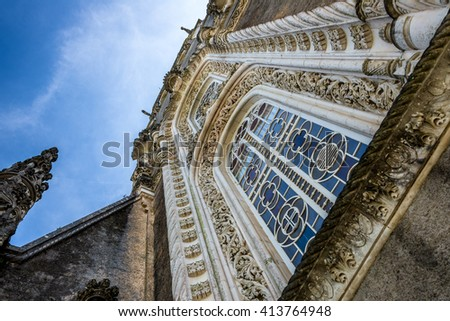 BUSSACO, PORTUGAL - 27 APRIL 2014: Looking upward at one of the main stained glass windows of the luxury hotel at Bussaco Palace near Luso in Portugal. - stock photo