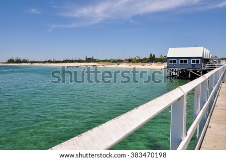 Busselton Jetty view and people in ocean in Australia/Busselton Jetty: Indian Ocean/BUSSELTON,WA,AUSTRALIA-JANUARY 15,2016:Busselton Jetty,Indian Ocean and people in Busselton,Western Australia. - stock photo