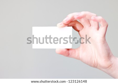 bussines card in hand for your information and logo in a grey background - stock photo