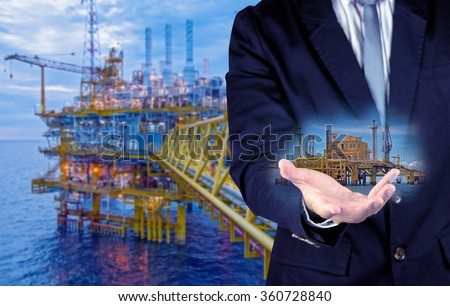bussinessman and offshore rig concept - stock photo
