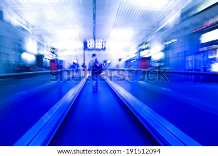 Busy airport conveyor belt - stock photo
