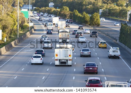 Busy Australian M1 highway at peak hour - stock photo