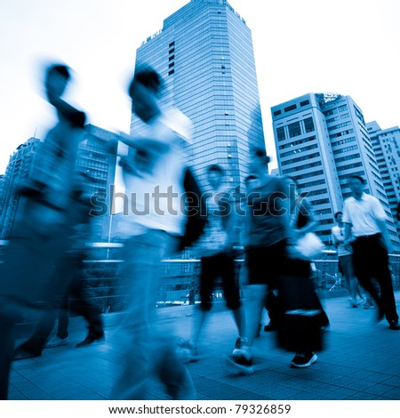 Busy big city people on street - stock photo