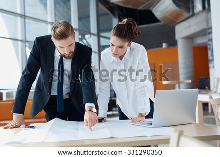 Busy business people working at office with architecture design