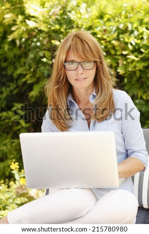 Busy business woman working with laptop at home.