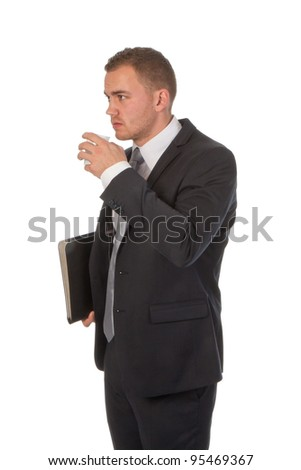 Busy businessman is taking a small coffee break; isolated on white