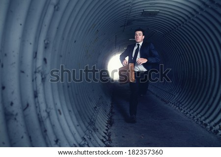 Busy Businessman Running in a tunnel. With Room for your Text. - stock photo