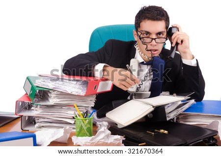 Busy businessman under work stress - stock photo