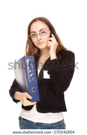 Busy businesswoman with a lot of folders and cup of coffee calling by phone - stock photo