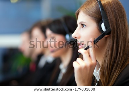 Busy call center operators in a modern office