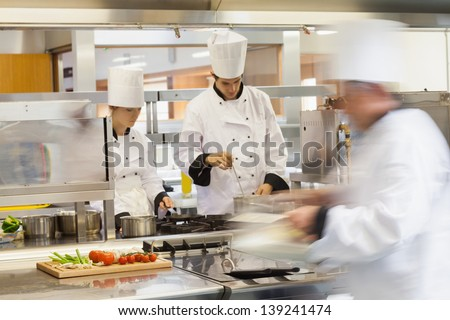 Busy chefs at work in the restaurant kitchen