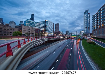 Busy city highway at twilight. Image of interstate I-90/94 in Chicago downtown during the twilight. - stock photo
