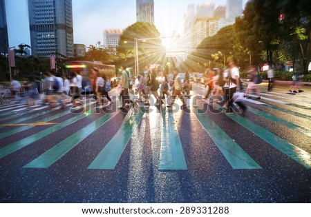 busy city people crowd on zebra crossing street - stock photo