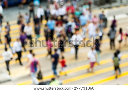 Busy city people on zebra crossing street in Hong Kong - stock photo