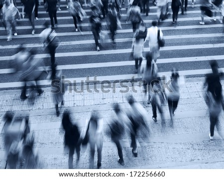 Busy city people on zebra crossing street in Hong Kong, China. - stock photo