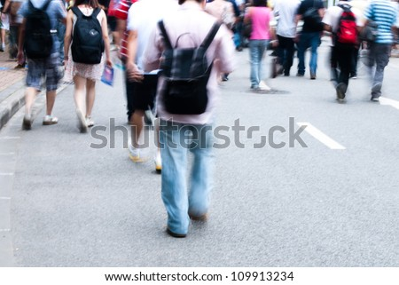 Busy city people walking on street in motion blur - stock photo