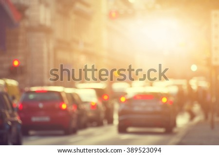 Busy city road with cars on a sunny day