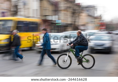 Busy city street people on zebra crossing. Intentional motion blur - stock photo