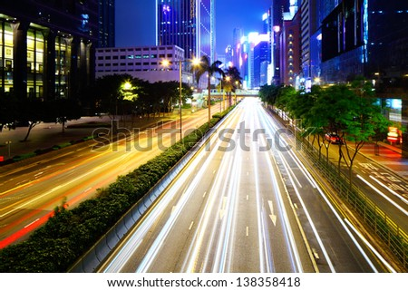 busy city traffic road at night - stock photo