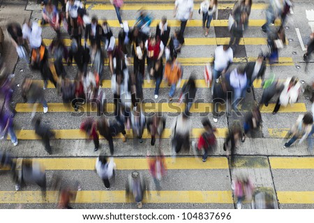 Busy Crossing Street in Hong Kong, China.