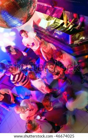 Busy dance floor in a nightclub near the DJ booth - stock photo