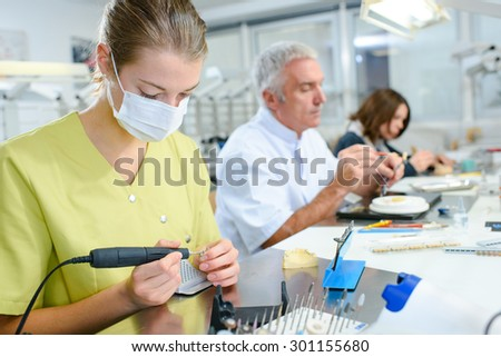 Busy dentist with a patient - stock photo
