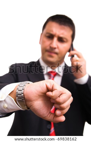 Busy man checking time - stock photo