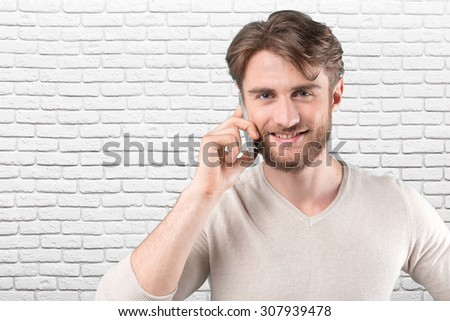 Busy man talking on the phone - stock photo