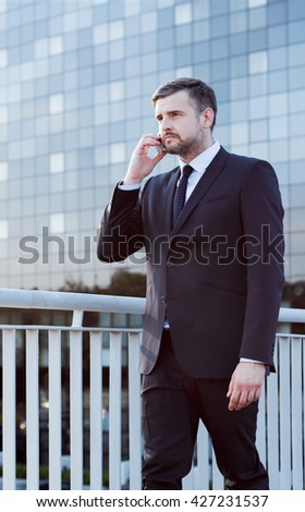 Busy man transacting with client on the phone