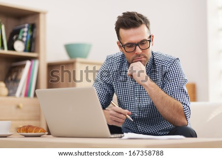 Busy man working at home - stock photo