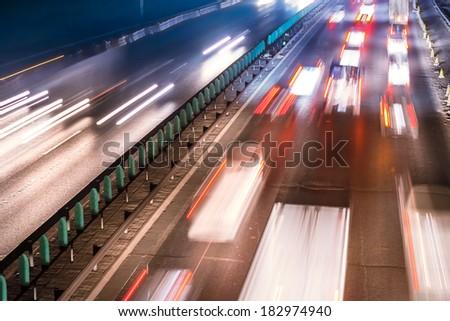 Busy Night Traffic Motion Blur - stock photo