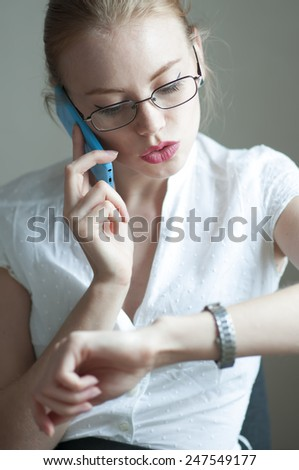 Busy office girl talking on mobile phone