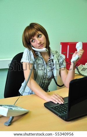 busy office woman talking by three phones - stock photo