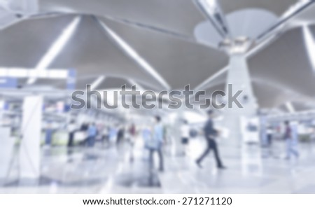 Busy people at airport in defocused blur concept with vintage color style and effects. - stock photo