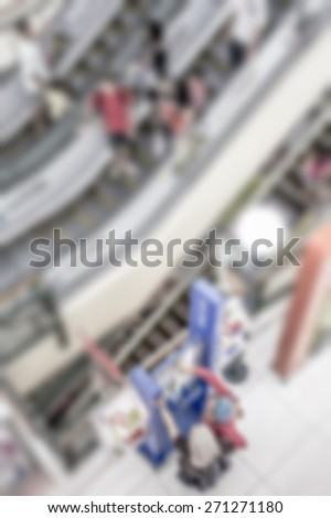 Busy people on escalator in defocused blur concept with vintage  color style and effects. - stock photo