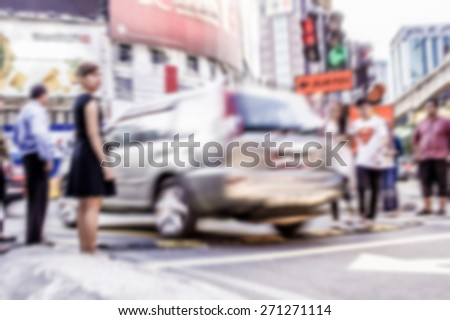 Busy people on street in defocused blur concept vintage color style. - stock photo