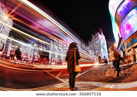 Busy Piccadilly Circus in London by night, England, UK - stock photo