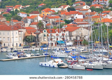 Busy pier crowded with sail boats near the old town of Trogir, Croatia