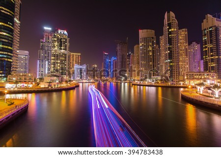 Busy promenade and the bay in Dubai Marina in the evening,Dubai,United Arab Emirates - stock photo