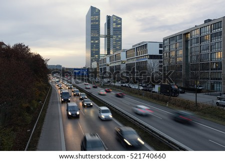 Busy road with office modern buildings in Munich, Germany, during the golden hour