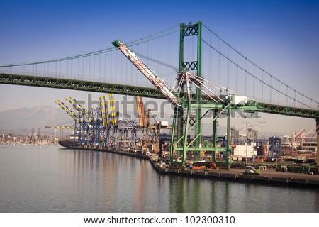 Busy San Pedro Ship Yard and Bridge. - stock photo