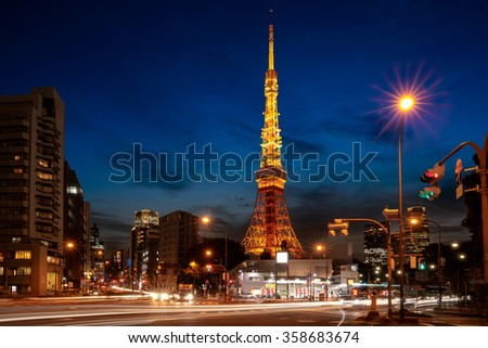 Busy street at night with tokyo tower in the distance in tokyo, Japan - stock photo