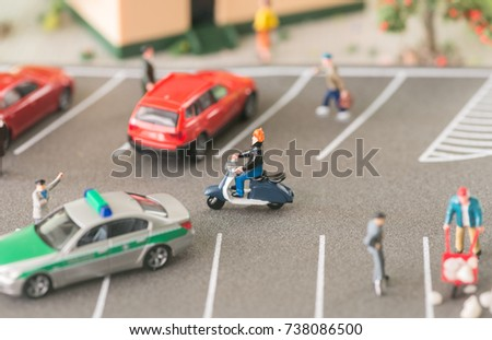 Busy street with miniature people and vehicles