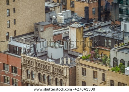 Busy Tar rooftops and gardens in midtown manhattan - stock photo