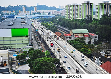 Busy traffic on highway in Singapore - stock photo