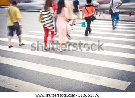 Busy urban street people on zebra crossing